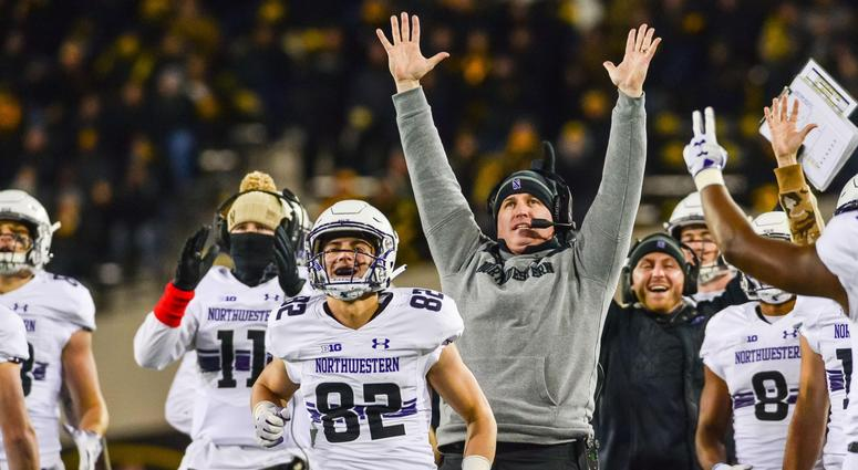 Northwestern coach Pat Fitzgerald and the Wildcats bench react after scoring a touchdown.