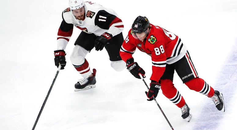 Blackhawks right wing Patrick Kane (88) skates with the puck.