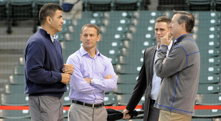 From left, Cubs executives Jason McLeod, Jed Hoyer and Theo Epstein chat with owner Tom Ricketts.
