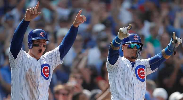 Anthony Rizzo, left, celebrates with Cubs teammate Javier Baez.