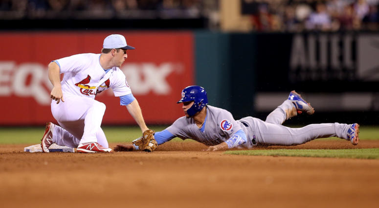 Cardinals infielder Jedd Gyorko (3) tags out Cubs catcher Willson Contreras (40).