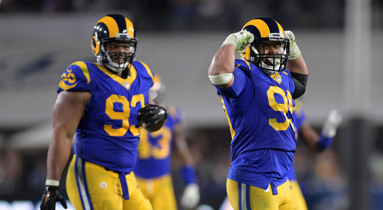Rams defensive linemen Ndamukong Suh, left, and Aaron Donald