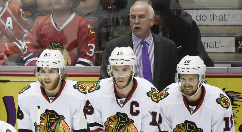 Blackhawks coach Joel Quenneville with, from left to right, Patrick Kane, Jonathan Toews and Marcus Kruger.