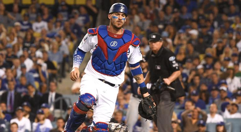 Dodgers catcher Yasmani Grandal chases a wild pitch.