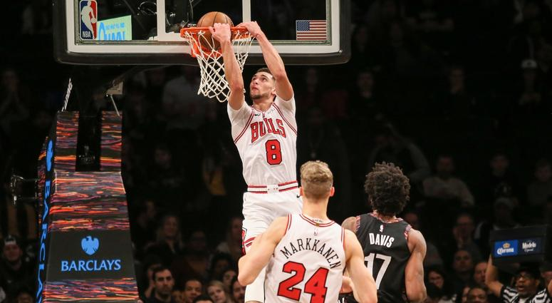 Bulls guard Zach LaVine (8) dunks the ball against the Nets.