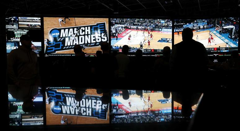 Fans watch the NCAA Tournament at the Westgate Superbook sports book in Las Vegas in March 2018.