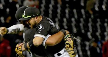White Sox first baseman Jose Abreu (79) celebrates with infielder Yolmer Sanchez.