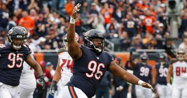 Bears defensive lineman Akiem Hicks celebrates after a play.