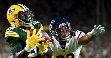 Packers receiver Geronimo Allison catches a touchdown pass as Bears cornerback Kyle Fuller defends.