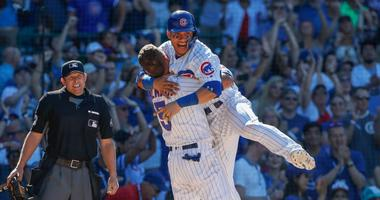 Albert Almora Jr. (5) celebrates with Cubs catcher Willson Contreras (40) after the team beat the Reds.