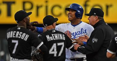 White Sox shortstop Tim Anderson (7) and Royals catcher Salvador Perez exchange words.