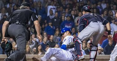 Indians catcher Yan Gomes (7) tags out Cubs first baseman Anthony Rizzo (44) at the plate.