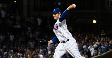 Cubs first baseman Anthony Rizzo pitches in relief.