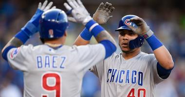 Willson Contreras (40) celebrates with Cubs teammate Javier Baez (9) after hitting a homer.