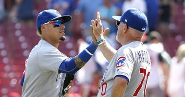 Cubs infielder Javier Baez, left, and manager Joe Maddon congratulate one another after a win.