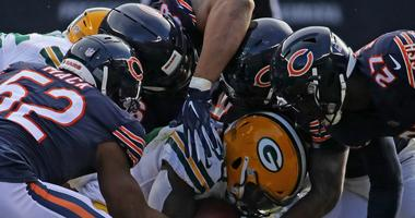 The Bears defense tackles Packers running back Jamaal Williams.