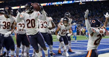 The Bears celebrate after a game-sealing interception by cornerback Kyle Fuller (23) in a win against the Lions.