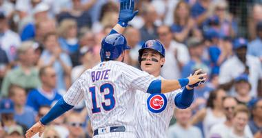 Anthony Rizzo (44) celebrates with Cubs teammate David Bote (13) after hitting a homer.