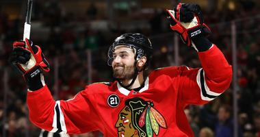 Blackhawks forward Brendan Perlini celebrates after scoring a goal in a win against the Coyotes.