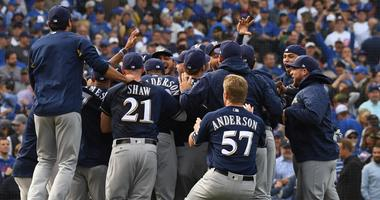 The Brewers celebrate after beating the Cubs in Game 163 to win the NL Central.