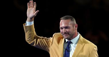 Brian Urlacher waves at the Hall of Fame festivities.