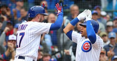 ubs catcher Willson Contreras (right) celebrates with third baseman Kris Bryant (17) after hitting a home run.
