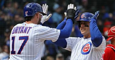Kris Bryant (17) congratulates Cubs teammate Anthony Rizzo after Rizzo homered.