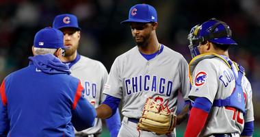 Cubs reliever Carl Edwards Jr. (6) hands the ball over to manager Joe Maddon as he's pulled from the game.
