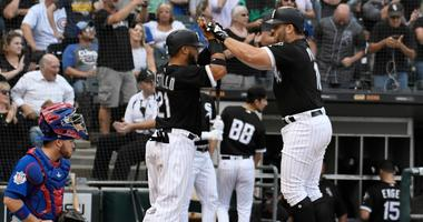 Daniel Palka, right, is greeted by White Sox teammate Welington Castillo after homering.