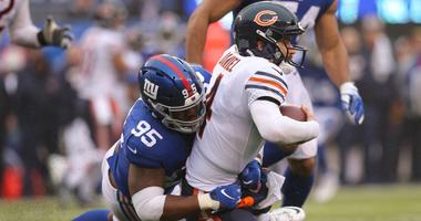 Bears quarterback Chase Daniel (4) is sacked by Giants defensive tackle B.J. Hill (95).
