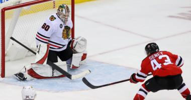 Devils winger Brett Seney (43) scores a goal on Blackhawks goaltender Collin Delia (60).