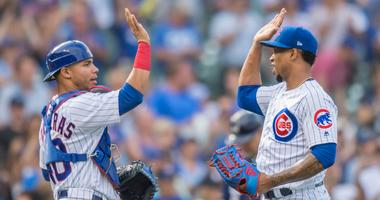 Cubs catcher Willson Contreras, left, and reliever Pedro Strop celebrate a win.