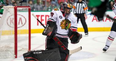 Blackhawks goalie Corey Crawford (50) stops a shot in a win against the Stars.