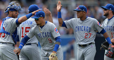 The Cubs celebrate after a win over the Padres.