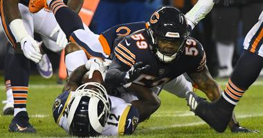 Rams receiver Brandin Cooks (12) makes a catch in front of Bears linebacker Danny Trevathan (59).
