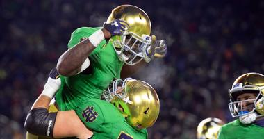 Notre Dame running back Dexter Williams (2) celebrates with offensive lineman Robert Hainsey (72) after a touchdown.