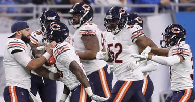 The Bears celebrate after safety Eddie Jackson (39) returned an interception for a touchdown.
