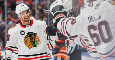 Blackhawks defenseman Erik Gustafsson (56) celebrates a goal against the Oilers.
