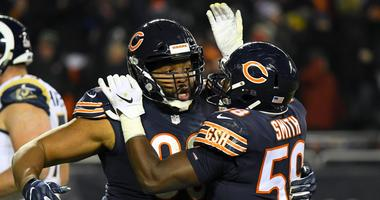 Bears defensive end Akiem Hicks (96) reacts with linebacker Roquan Smith (58).