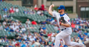 Cubs infielder/outfielder Ian Happ pitches in relief.