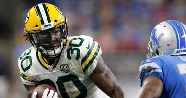Packers running back Jamaal Williams, left