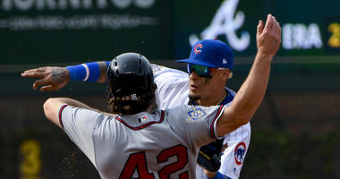 Braves shortstop Charlie Culberson (16) is caught stealing by Cubs second baseman Javier Baez.