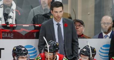 Blackhawks coach Jeremy Colliton looks on before a game against the Hurricanes.