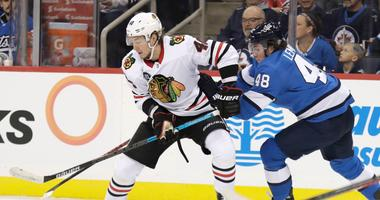Blackhawks winger John Hayden (40) looks to control the puck.