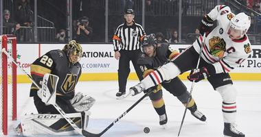 Knights goalie Marc-Andre Fleury blocks a shot by Blackhawks center Jonathan Toews (19).
