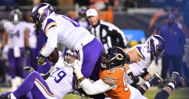Vikings quarterback Kirk Cousins (8) is sacked by Bears linebacker Khalil Mack (52).