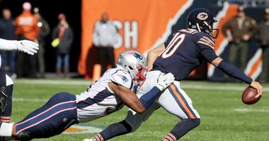 Patriots defensive lineman Deatrich Wise tackles Bears quarterback Mitchell Trubisky.