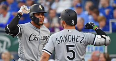 Yoan Moncada, left, is congratulated by White Sox teammate Yolmer Sanchez after homering.