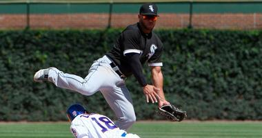 White Sox second baseman Yoan Moncada makes a throw as Cubs outfielder Ben Zobrist slides in during a 2017 game.