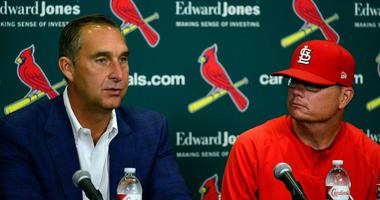 Cardinals president of baseball operations John Mozeliak, left, and manager Mike Shildt